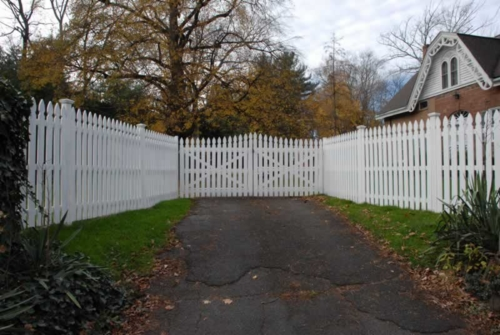 Painted Cedar French Gothic Spaced Picket with High to Low Double Drive Gate