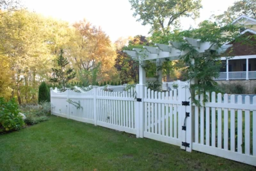 """Classic 3"""" Scalloped Picket Fence with Dogear Picket Caps with Gate installed in a Pergola"""